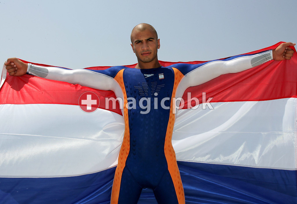 A model presents the swimsuit of the Dutch olympic swimming team during a photocall at the Olympic Games 2004 in Athens, Monday 09 August 2004. (Photo by Patrick B. Kraemer / MAGICPBK)