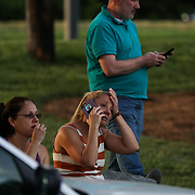 CHARLOTTE NC - APRIL 30: Family members and friends wait for their loved ones at a staging area  after a shooting on the University of North Carolina Charlotte campus in University City, Charlotte, NC on April 30, 2019.  Charlotte Mecklenburg police created the staging area a half mile from campus in the parking lot of a Harris Teeter grocery store.  (Logan Cyrus for AFP)