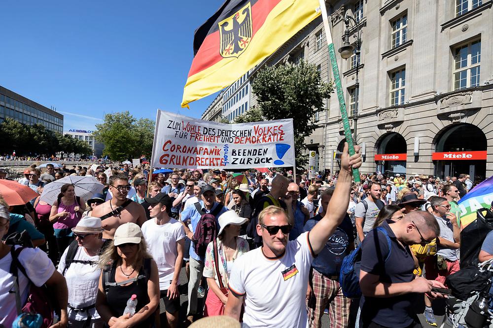"""01 AUG 2020, BERLIN/GERMANY:<br /> Demonstraten mit Banner """"Zum Wohle des Deutschen Volkes für Freiheit und Demokartie - Coronapanik beenden - Grundrechte zurück!"""" und Bundesflagge, Demonstration gegen die Einschraenkungen in der Corona-Pandemie durch die Initiative """"Querdenken 711"""" aus Stuttgart unter dem Motto """"Das Ende der Pandemie - Tag der Freiheit"""", Unter den Linden<br /> IMAGE: 20200801-01-032<br /> KEYWORDS: Demo, Protest, Demosntranten, Protester, COVID-19, Corona-Demo"""