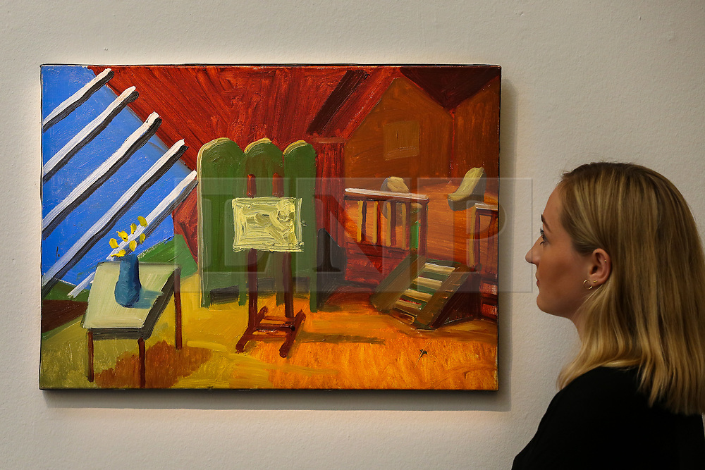 "© Licensed to London News Pictures. 27/09/2019. London, UK. A staff member view David Hockney's artwork titled ""Bridlington Studio Interior"" Est £900,000 - £1,200,000 during the preview of Sotheby's Frieze Week Contemporary Art Sale. The auction will take place on 3rd October 2019.  Photo credit: Dinendra Haria/LNP"