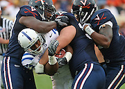 Duke running back Desmond Scott (33) is rapped up by Virginia defenders during an ACC football game Saturday in Charlottesville, VA. Duke won 28-17. Photo/Andrew Shurtleff