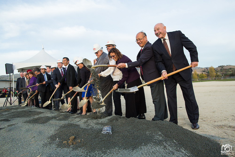 Dignitaries shovel dirt during the Milpitas Unified School District and San Jose Evergreen Community College District Community College Extension Ground Breaking Ceremony near Russell Middle School in Milpitas, California, on November 17, 2015. (Stan Olszewski/SOSKIphoto)