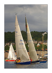 Yachting- The first days racing  of the Bell Lawrie Scottish series 2003 at Gourock.  The wet start looks set to last for the overnight race to Tarbert...Donald Sharp in Tundra 3072C rolling behind IRL 31416 Blue Berret Pie at the Gourock Start. Class Three...Pics Marc Turner / PFM