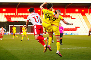 Danny Newton of Stevenage, Callum Cockerill-Mollett of Walsall and Dan Scarr of Walsall all go in for a header during the EFL Sky Bet League 2 match between Stevenage and Walsall at the Lamex Stadium, Stevenage, England on 20 February 2021.