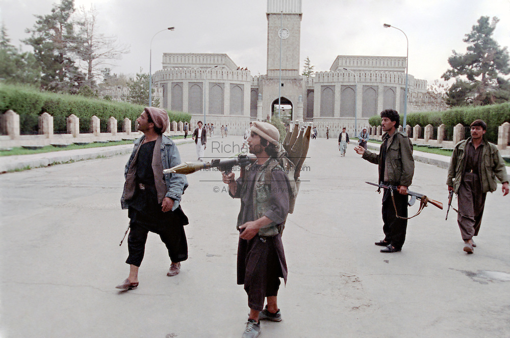 Afghan mujahideen fighters with Jamayat-E-Islami enter the Presidential Palace and search for Afghan soldiers at they take control of the capital April 18, 1992 in Kabul, Afghanistan. The Jamayat-E-Islami were the first to enter Kabul and took control of most of the strategic buildings in the city.