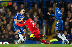 11.11.2012, Stamford Bridge, London, ENG, Premier League, FC Chelsea vs FC Liverpool, 11. Runde, im Bild Chelsea's captain John Terry injures himself as he lunges in on Liverpool's Luis Alberto Suarez Diaz during the English Premier League 11th round match between Chelsea FC and Liverpool FC at the Stamford Bridge, London, Great Britain on 2012/11/11. EXPA Pictures © 2012, PhotoCredit: EXPA/ Propagandaphoto/ David Rawcliffe..***** ATTENTION - OUT OF ENG, GBR, UK *****