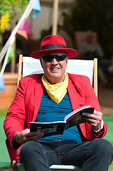 © Licensed to London News Pictures. 28/05/2016. Hay-on-Wye, Powys, Wales, UK.  A flamboyant dresser seen at The Hay Festival. Fine weather on the third day of the Hay Festival at Hay-on-Wye, Wales. Photo credit: Graham M. Lawrence/LNP