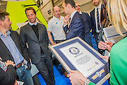 Sir Ben Ainslie is awarded a Guinness Book of World Records certificate on behalf of the Andrew (Bart) Simpson Sailing foundation. The award was for the largest multiple location sailing race in the world - Bart's Bash. The CWM FX London Boat Show, taking place 09-18 January 2015 at the ExCel Centre, Docklands, London. 09 Jan 2015.