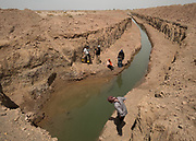 The scientific team look at the water exiting from an underground Qanat (traditional well).