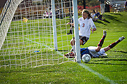 Patty Murphy-Geiss '14 reacts to her tap-in going just wide of the net during the second half of the Pioneers' 1-0 overtime victory over Coe College on Sunday