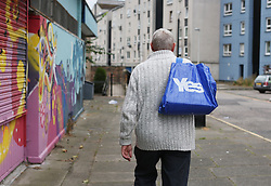 © Licensed to London News Pictures. 14/09/2014. Edinburgh, UK. A volunteer from the Yes campaign delivers leaflets and knocks on doors to to gain new voters. With only  four days left to decide on the Scottish referendum, the latest polls give a mixed picture of opinions. Photo credit: Isabel Infantes / LNP