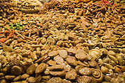Piles of Moroccan sweets for sale at a market in the Marrakech medina, Morocco.