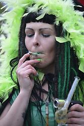 May 6, 2017 - Toronto, Ontario, Canada - A woman smoking Marijuana during the Global Marijuana March in Toronto. Canada is on its way to legalize cannabis/ Marijuana in 2018. (Credit Image: © Arindam Shivaani/NurPhoto via ZUMA Press)