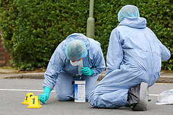 © Licensed to London News Pictures. 19/06/2019. London, UK. Forensic officers next to the evidence markers on Wellbeck Road, Barnet, North London  where three men were found to be suffering stab injuries on Tuesday 18 June 2019, just before 11pm. A man in his 30s was treated at the scene, but he was pronounced dead shortly after midnight. Two other men – one in his 20s and one in his 30s were taken to hospital for treatment.  Photo credit: Dinendra Haria/LNP