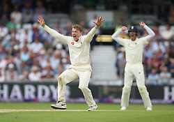 England's Dom Bess celebrates after taking the wicket of Pakistan's Imam ul-Haq during day three of the Second NatWest Test match at Headingley, Leeds.