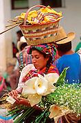 GUATEMALA, HIGHLANDS, MARKETS Solol� near Lake Atitlan; market day on main plaza; woman selling flowers