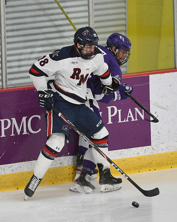 PITTSBURGH, PA - MARCH 12: Gavin Gulash #18 of the Robert Morris Colonials battles along the boards with Jason Pineo #12 of the Niagara Purple Eagles in the first period during Game One of the Atlantic Hockey Quarterfinal series at Clearview Arena on March 12, 2021 in Pittsburgh, Pennsylvania. (Photo by Justin Berl/Robert Morris Athletics)