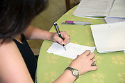 woman writing a note Model release available