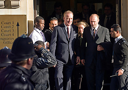 © Licensed to London News Pictures. 07/12/2011. London, UK. Entertainer Michael Barrymore (centre) leaving Ealing Magistrates Court today (07/12/2011) where he pleaded guilty to possessing cocaine and was  fined £680 plus £100 in costs, following his arrest at the scene of a car crash last month.. The 59-year-old was held at 4.30am on November 22 after a Citroen DS3 hit a kerb in Acton, west London.. Photo credit: Ben Cawthra/LNP