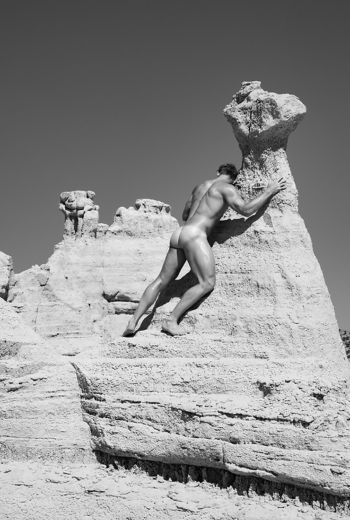 nude male on a rock formation