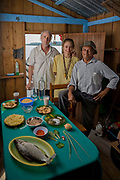 Faith D'Aluisio and Peter Menzel, authors of the book What I Eat: Around the World in 80 Diets with fisherman João Agostinho Cardoso da Silva at his floating house on a branch of the Solimoes River near Manacapuru, Brazil. (João Agostinho Cardoso da Silva is featured in the book What I Eat: Around the World in 80 Diets.) Photo was taken after the food portrait. MODEL RELEASED.  PJM