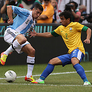 Jose Sosa, Argentina, (left) is challenged by Rafael Silva, Brazil, during the Brazil V Argentina International Football Friendly match at MetLife Stadium, East Rutherford, New Jersey, USA. 9th June 2012. Photo Tim Clayton
