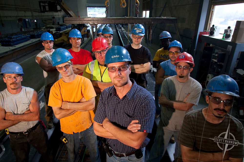 Hard hat workers in a factory situation.