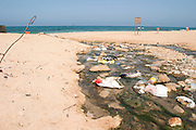 Garbage and waste left by holiday makers on a beach. Photographed in Israel