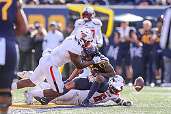Nov 9, 2019; Morgantown, WV, USA; West Virginia Mountaineers wide receiver Winston Wright (16) fumbles the ball with Texas Tech Red Raiders linebacker Jordyn Brooks (1) and Texas Tech Red Raiders linebacker Riko Jeffers (6) defending during the third quarter at Mountaineer Field at Milan Puskar Stadium. Mandatory Credit: Ben Queen-USA TODAY Sports