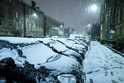 Edinburgh, Scotland, UK. 21 January 2020. Scenes taken between 4am and 5am in Edinburgh city centre after overnight snow fall. Pic; Cars covered in snow in the New Town. Iain Masterton/Alamy Live News