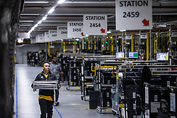 "© Licensed to London News Pictures . 04/12/2019. Manchester , UK . Inside the ""MAN1"" Amazon fulfilment centre warehouse at Manchester Airport in the North West of England . Photo credit : Joel Goodman/LNP"