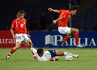 Fotball<br /> VM-kvalifisering<br /> Polen v Aserbaijan / Azerbaijan<br /> Foto: Wrofoto/Digitalsport<br /> NORWAY ONLY<br /> <br /> Miroslaw Szymkowiak (10) - Polen - Kamal Guliyew (6) - Aserbaijan - Maciej Zurawski (9) - Polen
