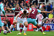 Marko Arnautovic of Stoke battles for the ball with Winston Reid of West Ham . Premier league match, Stoke City v West Ham Utd at the Bet365 Stadium in Stoke on Trent, Staffs on Saturday 29th April 2017.<br /> pic by Bradley Collyer, Andrew Orchard sports photography.