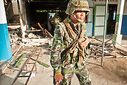 """Sept. 29, 2009 -- YARANG, THAILAND: Thai soldiers clean up after a mysterious explosion in an elementary school office in rural Pattani province, Sept. 29. Muslim militants frequently target schools because they claim the public schools are a symbol of the Bangkok government. No one was hurt in the explosion and the official cause of the blast was undetermined.  Thailand's three southern most provinces; Yala, Pattani and Narathiwat are often called """"restive"""" and a decades long Muslim insurgency has gained traction recently. Nearly 4,000 people have been killed since 2004. The three southern provinces are under emergency control and there are more than 60,000 Thai military, police and paramilitary militia forces trying to keep the peace battling insurgents who favor car bombs and assassination.  PHOTO BY JACK KURTZ"""