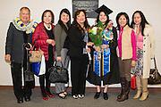 San Jose State University department of Child & Adolescent Development graduates pose for a portrait during their graduation ceremony at San Jose State University's Event Center Arena in San Jose, California, on December 18, 2014. (Stan Olszewski/SOSKIphoto)