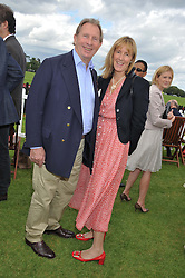 PADDY McNALLY and SARAH TYZACK at the Cartier Queen's Cup Polo Final, Guards Polo Club, Windsor Great Park, Berkshire, on 17th June 2012.