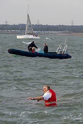 © London News Pictures. 17/09/2012. Southampton, UK.  A cricketer wading through water to reach the sand bank. Teams play a cricket match on the Bramble Bank in the middle of The Solent on September 17, 2012.  The annual cricket match between the Royal Southern Yacht Club and The Island Sailing Club, takes place on a sandbank which appears for 30 minutes at lowest tide. The game lasts until the tide returns. Photo credit : Ben Cawthra/LNP.