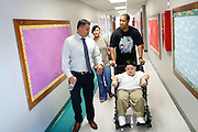 Principal Tony Frascone walks with Noah Stout, 7, and his parents Michelle and Anthony after Noah's first visit to Hilary Leday's second grade class since being diagnosed with Diffuse Intrinsic Pontine Glioma (DIPG), a rare and non-operable tumor located on the brain stem, at Sinnott Elementary School in Milpitas, California, on August 29, 2013. (Stan Olszewski/SOSKIphoto)