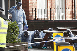 © Licensed to London News Pictures. 03/12/2018. London, UK. Police conduct a search outside The Garden Shed pub near the scene in Wimbledon where a man was shot by police on a pre-planned operation this morning. Photo credit: Peter Macdiarmid/LNP