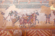 Detail of a chariotracing at the Circus Maximus Chariot racing at the Circus Maximus from the Palaestra room no 15.. Roman mosaics at the Villa Romana del Casale which containis the richest, largest and most complex collection of Roman mosaics in the world. Constructed  in the first quarter of the 4th century AD. Sicily, Italy. A UNESCO World Heritage Site. .<br /> <br /> If you prefer to buy from our ALAMY PHOTO LIBRARY  Collection visit : https://www.alamy.com/portfolio/paul-williams-funkystock/villaromanadelcasale.html<br /> Visit our ROMAN MOSAIC PHOTO COLLECTIONS for more photos to buy as buy as wall art prints https://funkystock.photoshelter.com/gallery/Roman-Mosaics-Roman-Mosaic-Pictures-Photos-and-Images-Fotos/G00008dLtP71H_yc/C0000q_tZnliJD08
