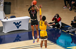 Jan 25, 2021; Morgantown, West Virginia, USA; Texas Tech Red Raiders guard Terrence Shannon Jr. (1) shoots a jumper over West Virginia Mountaineers forward Jalen Bridges (2) during the first half at WVU Coliseum. Mandatory Credit: Ben Queen-USA TODAY Sports