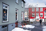 Typical buildings - cafe restaurant and shops - and melting snow in the old town area of capital city of Reykjavik, Iceland