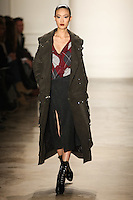 Shu Pei Qin walks the runway wearing Altuzarra Fall 2011 Collection during Mercedes-Benz Fashion Week in New York on February 12, 2011