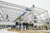 """Ward D'Elia Samyn-D'Elia Architects, Sgt C.H. McLain Marine Patrol, Capt Tim Dunleavy Marine Patrol, John Howard Marine Patrol, Paul Kent Harvey Construction and Capt William Haynes NH State Police stand in front of the final steele beam with their signatures with Ethan Chalke and Jim Johnson (above) from American Steele during the """"Topping Off"""" ceremony at Gilford Marine Patrol Monday morning.  (Karen Bobotas/for the Laconia Daily Sun)"""