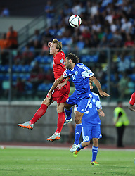 Harry Kane of England (Tottenham Hotspur) battles for the high ball with Alessandro Della Valle of San Marino  - Mandatory byline: Joe Meredith/JMP - 07966386802 - 05/09/2015 - FOOTBALL- INTERNATIONAL - San Marino Stadium - Serravalle - San Marino v England - UEFA EURO Qualifers Group Stage