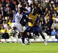 Photo: Mark Stephenson.<br /> Birmingham City v Hereford United. Carling Cup. 28/08/2007.Birmingham's Neil Danns keeps the  ball from Herefords Toumani Diagouraga