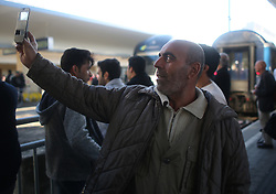 © London News Pictures. 06/09/2015. A migrant man uses his mobile device at Wien Westbahnhof train station, Vienna, Austria, September 6 2015.  Hundreds of migrants have resumed their journey through Austria to Germany after Hungary's decision on Friday to let them through. Picture by Paul Hackett/LNP