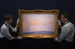 Sotheby's, London, January 28th 2016. Gallery technicians hang the exceptionally rare and important 1908 painting Le Palais Ducal vu de Saint-Georges Majeur, by Claude Monet, which is expected to fetch between £12 - 18 million and is to be auctioned by Sotheby's in London as part of their sale of Impressionist, Modern, Surrealist and Contemporary art. ///FOR LICENCING CONTACT: paul@pauldaveycreative.co.uk TEL:+44 (0) 7966 016 296 or +44 (0) 20 8969 6875. ©2015 Paul R Davey. All rights reserved.