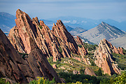 Roxborough State Park features strikingly tilted red sandstone formations in Colorado, USA. We hike up the pleasant Carpenter Peak Trail and back via Elk Valley loop and Fountain Overlook, 8.5 miles with 1600 feet gain. A shorter walk is to the Peak then directly back (6.2 miles and 1400 ft). Roxborough State Park is in Douglas County 25 miles south of Denver, Colorado, USA. Honored as a National Natural Landmark, Roxborough State Park features the spectacularly tilted sandstone of the Fountain Formation, laid down over 300 million years ago with the gradual erosion of the Ancestral Rocky Mountains. After millions of years of uplift and erosion, these red sandstones stand dramatically at a sixty degree angle. Also exposed is geology from the Precambrian to Late Mesozoic, including hogbacks of Cretaceous, Permian, and Pennsylvanian age. Erosion of steeply dipping monoclinal sedimentary sections has resulted in the series of three major hogbacks and strike valleys, exposing scenic dipping plates, spires and monoliths. Precambrian gneiss and biotite-muscovite granite are exposed on Carpenter Peak. The park is also a State Historic Site and National Cultural District, due to archaeological sites.
