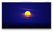 A beautiful harvest moon hangs over Erie Pennsylvania during the Perry 200 Commemoration, September 2013, USA